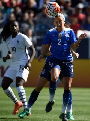 USA's Mallory Pugh, 2, heads the ball during the match as France's Griedge Mbock Bathy, 19,  looks on during the SheBelieves Cup game at Nissan Stadium on Sunday, March 6 in Nashville, Tenn.