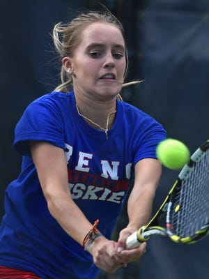 Reno High's McKenna Levitt reaches out to make a return backhand to opponent Madelyn Landerfelt of Douglas during the regional finals at the Caughlin Athletic Club on Oct. 19, 2015.