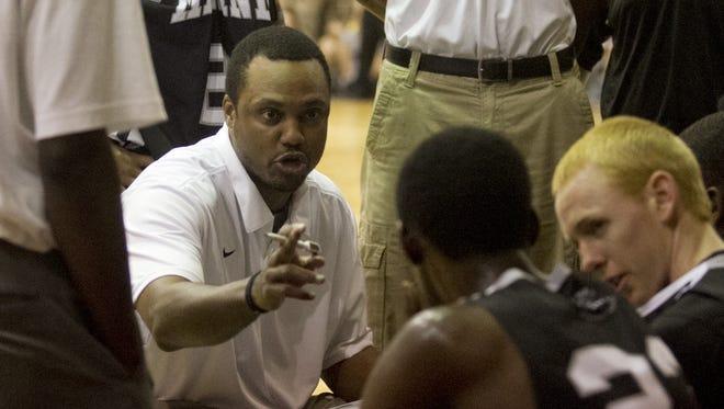 Mariner High School boys basketball coach James Harris coaches his team on Tuesday against Riverdale High School.