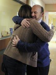 Dr. David Korones hugs LIz Conrow during a recent trip to Golisano Children's Hospital.