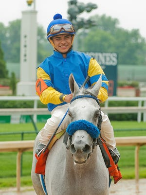 Jockey Sebastian Saez, 16, is all smiles as he approaches the winning circle aboard Miss Reditore in the 4th race, a claiming stakes race at Churchill Downs.19 June 2015