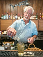 Owner and namesake Sam Camariotes prepares a drink