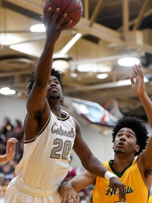 Henderson's Dada Simpson (20) shoots over University Height's Heekwun Dorsey (5) as the Henderson County Colonels play the University Heights Blazers at Colonel Gym in Henderson Tuesday, February 13, 2018.
