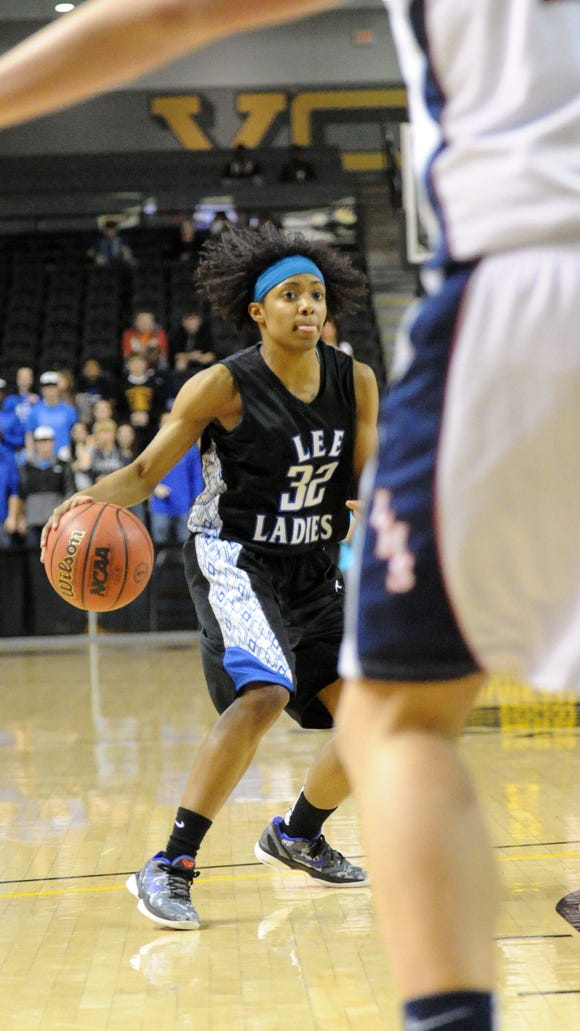 Mike Tripp/The News Leader Robert E. Lee's Angela Mickens has the ball during the first half of the Group AA, Division 3 championship game in Richmond on Saturday, March 10, 2012.