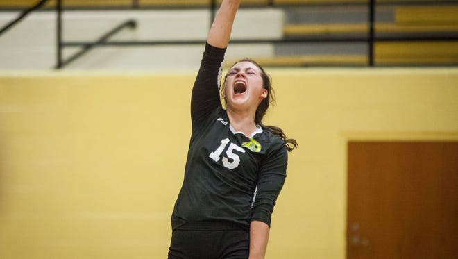Daleville's Lexi Leisure celebrates the win during the second set as the teams trade sides on Saturday during the class 1A Cowan sectional final at Cowan High School. Daleville swept the sectional 3-0 in three neck and neck sets.