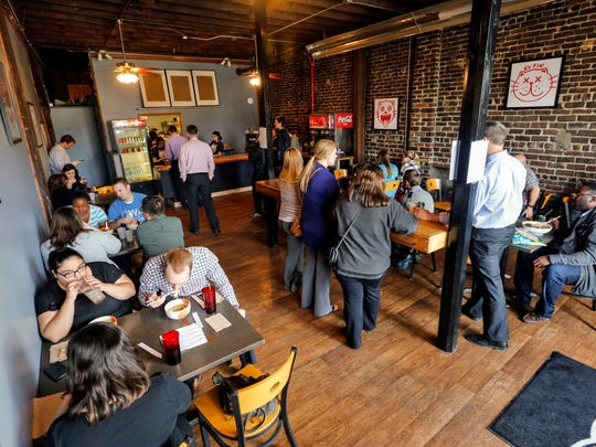 The lunch rush packed the newly opened Krunkwich restaurant in Des Moines' East Village on Wednesday.