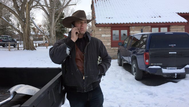 Ryan Bundy talks on the phone at the Malheur National Wildlife Refuge near Burns, Ore., on Jan. 3, 2016.