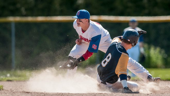 Port Huron Northern's Brett Manis slides safely into second on St. Clair's Josh Markel during a baseball game Thursday, May 19, 2016 at Port Huron Northern High School.