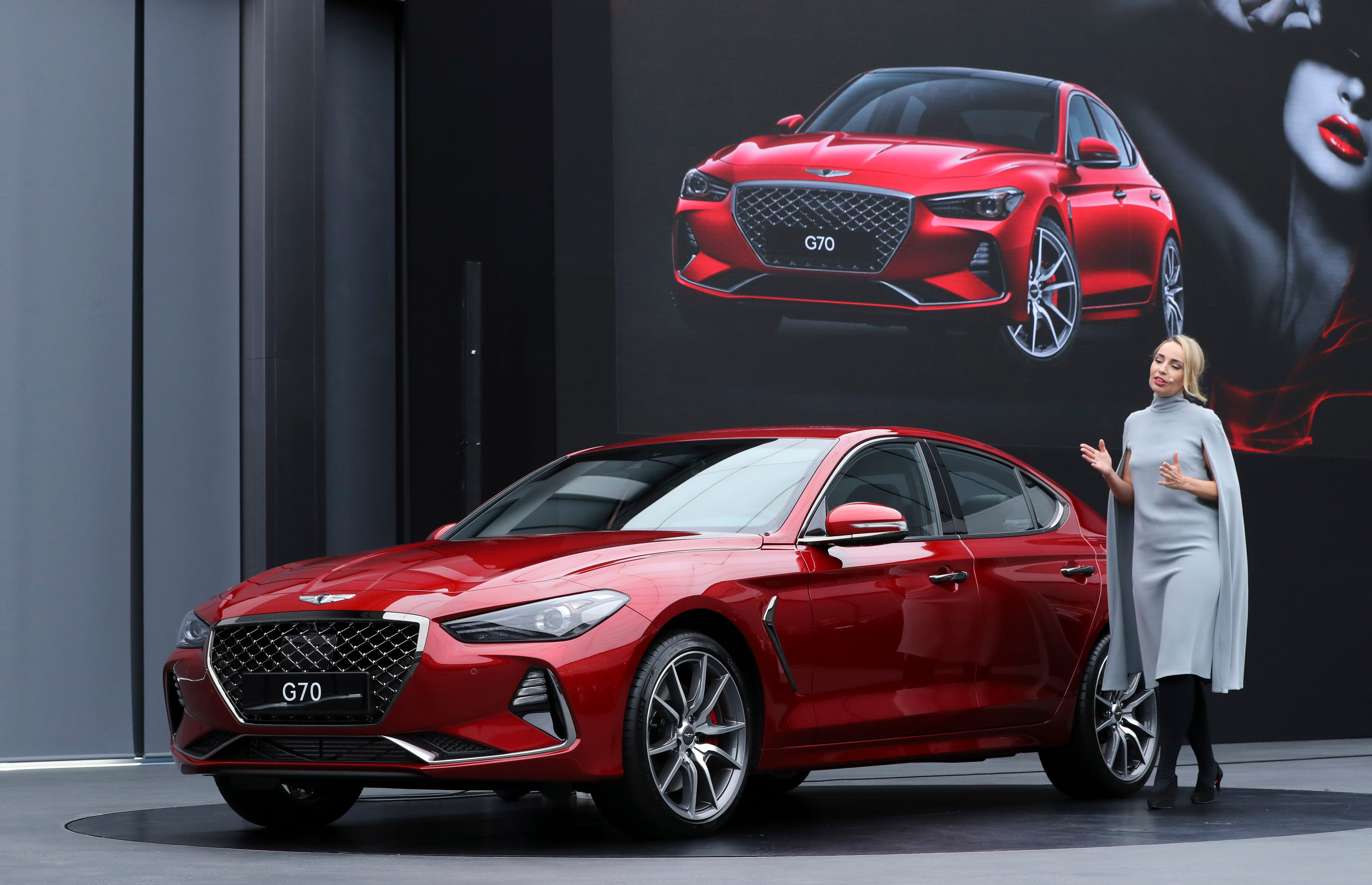 Bozhena Lalova, A Head Of Genesis Color And Trim Of Hyundai Motor Co.,  Speaks To The Media Next To A New Sedan Genesis G70 During Its Unveiling  Ceremony In ...