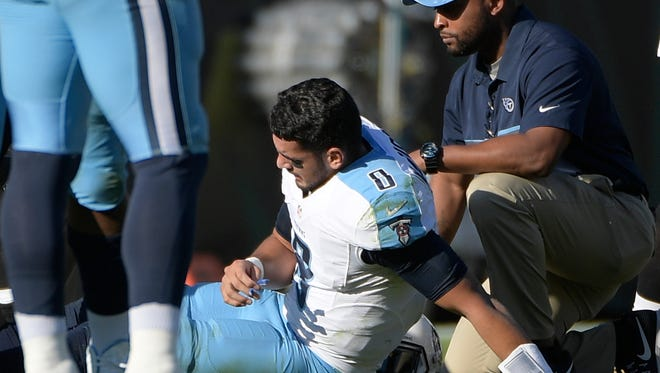 Titans quarterback Marcus Mariota sits up on the field after he was injured during the second half against the Jaguars on Dec. 24, 2016.