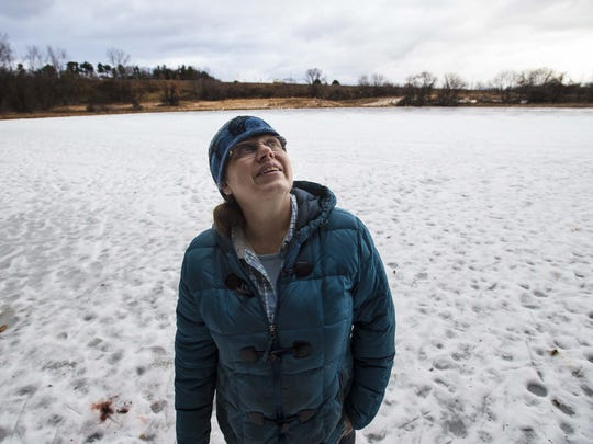 Alicia Daniel, naturalist for the city of Burlington, is seen near the Donahue Sea Caves in Burlington in late January.