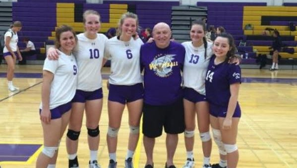 Mesa High PA announcer Virgil Schatz, center, with some of the Mesa volleyball players in 2015. From left, Lainey Shumway, Shannah Jensen, Heidi Carpenter, Audrey Veitel and Lindie Rowley.