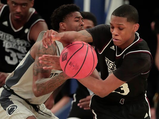 Mississippi State guard Tyson Carter (23) steals a pass from Penn State guard Jamari Wheeler (5) during the second half of an NCAA college basketball game in the semifinals of the NIT, Tuesday, March 27, 2018, in New York. Penn State won 75-60. (AP Photo/Julie Jacobson)
