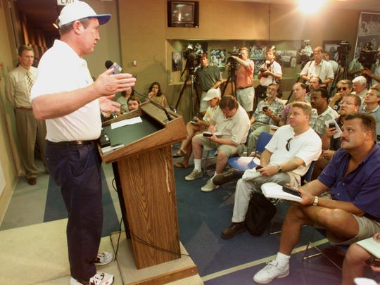 Detroit Lions head coach Bobby Ross answers questions from the media during a press conference on the sudden retirement of running back Barry Sanders on July 28, 1999, at the Pontiac Silverdome.
