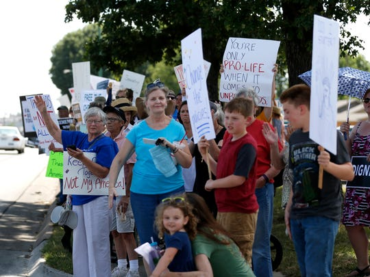 Around 300 protestors lined part of East Sunshine Street in front of Sen. Roy Blunt's office on Wednesday afternoon to protest immigration laws that has led to a greater number of family separations along the U.S.-Mexico border.