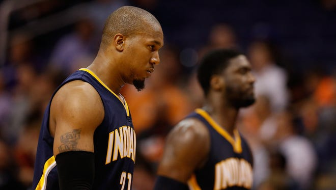 David West #21 and Roy Hibbert #55 of the Indiana Pacers check out of the NBA game late in the fourth quarter against the Phoenix Suns at US Airways Center on December 2, 2014 in Phoenix, Arizona.
