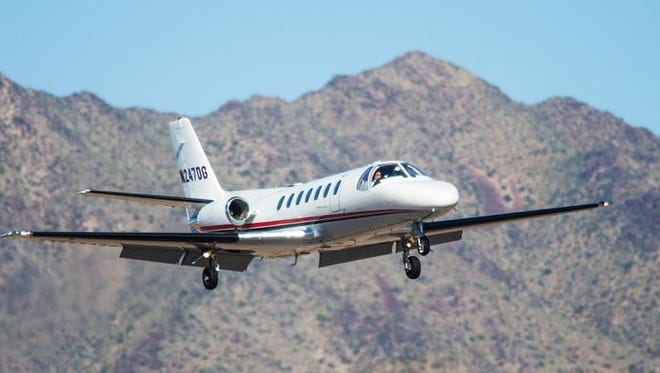 A small jet comes in for a landing at Scottsdale Airport on  March 10, 2015. The airport is one of the busiest corporate jet facilities in the state.