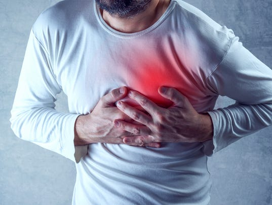 Severe heartache, man suffering from chest pain, having painful