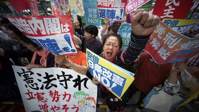 Protesters gather in front of the Diet building after the lower house was dissolved in Tokyo Thursday, Sept. 28, 2017.