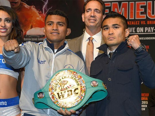 """Roman """"Chocolatito"""" Gonzalez, left, poses with Saturday's opponent, Brian Viloria, after their weigh-in Friday. (Photo: Tom Hogan, Golden Boy Promotions)"""