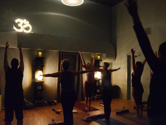 A yogo class in session at Centering Yoga.
