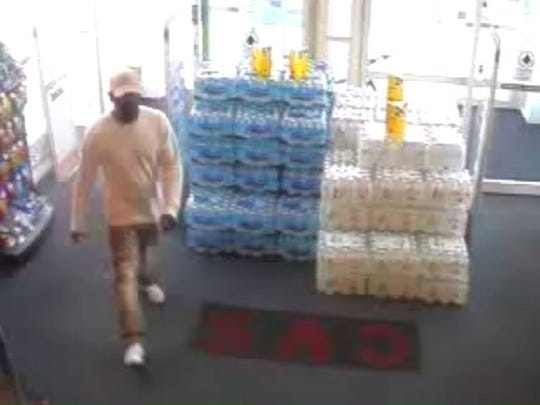 Richmond Police Department investigators are searching for this suspect in Thursday's robbery of the west-side CVS.