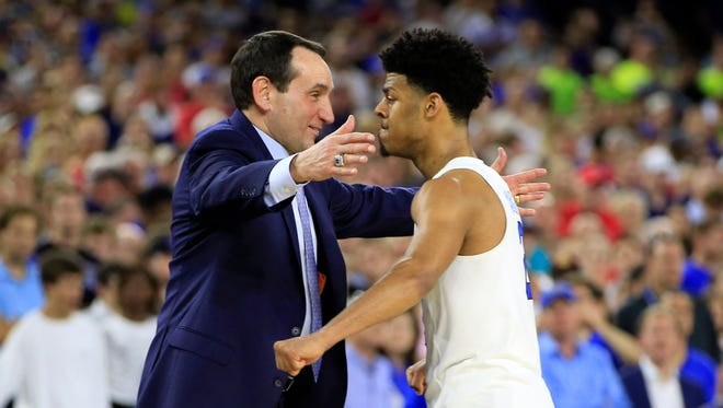 Duke Blue Devils head coach Mike Krzyzewski hugs guard Quinn Cook (2) during the second half in the finals of the south regional of the 2015 NCAA Tournament against the Gonzaga Bulldogs at NRG Stadium.