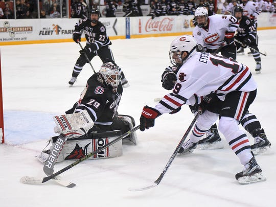 St. Cloud State's Mikey Eyssimont tries to get the