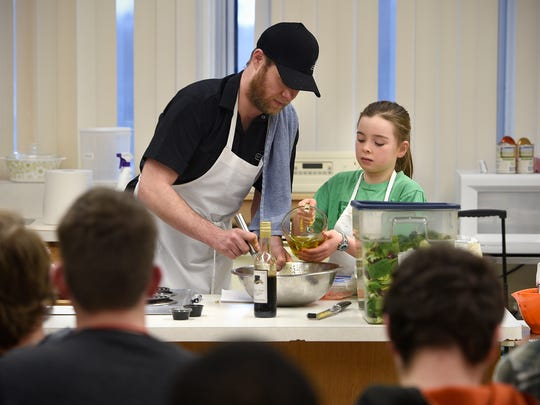Ava Nebben works with White Horse chef Tommy Lee to