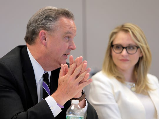 Marty Scott from Meridan Health speaks while Sarah Adelman from the New Jersey Association of Health Plans looks on during the Asbury Park Press Business Roundtable on health care affordability in Neptune.