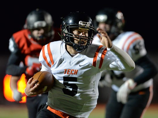 St. Cloud Tech quarterback Chris Backes (5) rushes