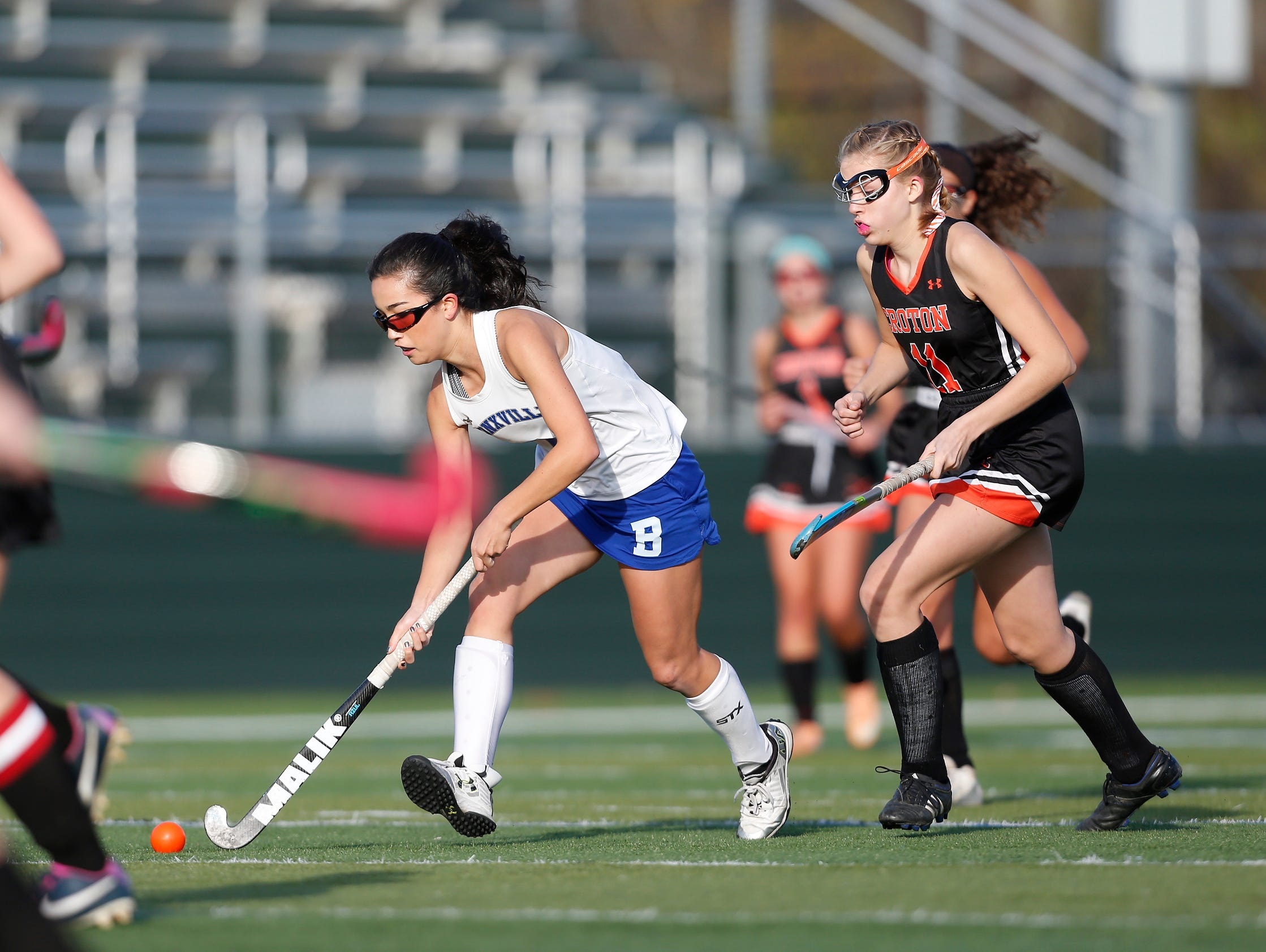 Bronxville's Hanna Weirens (6) advances the ball past Croton's Julia Danett (11) during their 7-1 win in the Class C field hockey sectiion finals at Brewster High School on Tuesday, November 1, 2016.