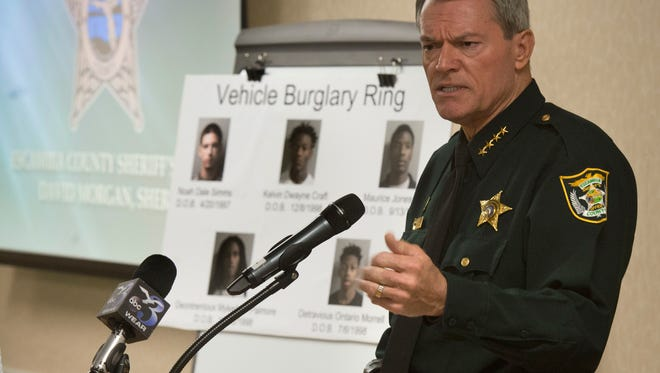 Escambia County Sheriff David Morgan announces the arrest of several people in connection to a sting of local car burglaries during a press conference Friday morning Jan. 22, 2016. The investigation into the crimes began early Dec. of last year.