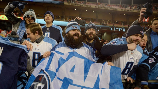 Titans fans cheer the team's win in the AFC wild-card game in January at Arrowhead Stadium.