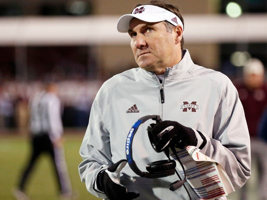 Mississippi State coach Dan Mullen gives the scoreboard in the closing seconds of the team's 31-28 loss to Mississippi in anNCAA college football game in Starkville, Miss., Thursday, Nov. 23, 2017. (AP Photo/Rogelio V. Solis)