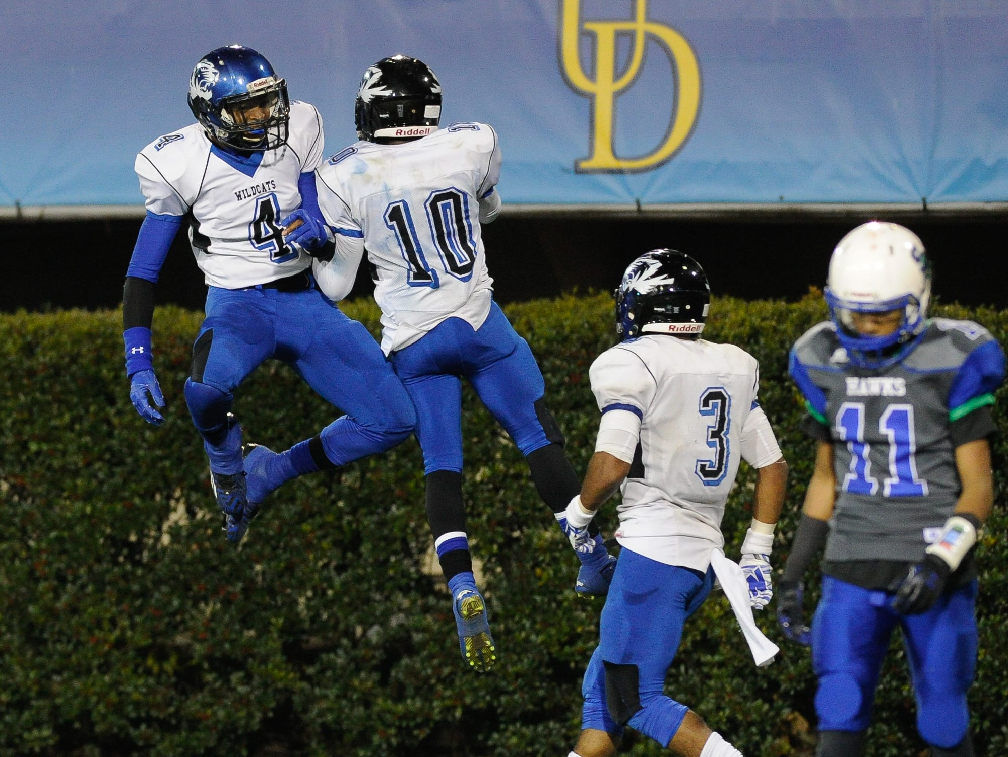 Howard's #4 Earnest Austin and #10 Korey Kent celebrate after scoring against St. George in the Division II championship at the University of Delaware.