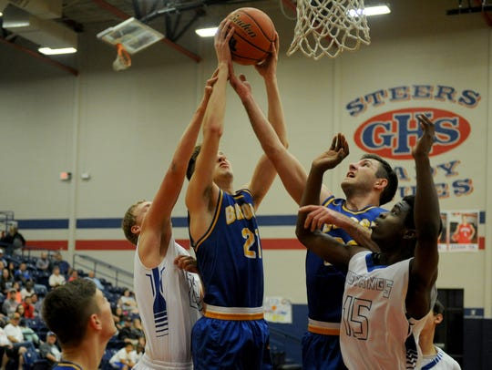 Brock's Scott Thomas grabs the rebound in the playoff