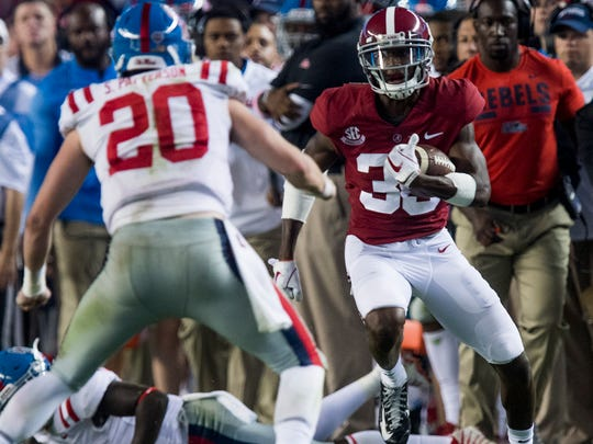 Alabama defensive back Levi Wallace (39) returns an interception against Ole Miss in second half action at Bryant-Denny Stadium in Tuscaloosa, Ala. on Saturday September 30, 2017. (Mickey Welsh / Montgomery Advertiser)