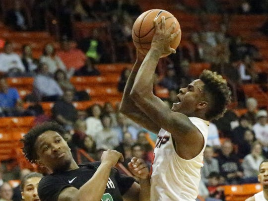 Evan Gilyard, right, of UTEP takes a shot against North Texas Thursday night.