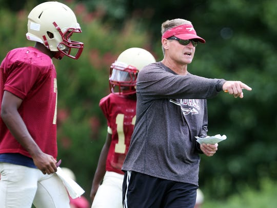 Riverdale head football coach Ron Aydelott leads practice on the first day with pads Monday, July 28, 2014 at Riverdale High School.