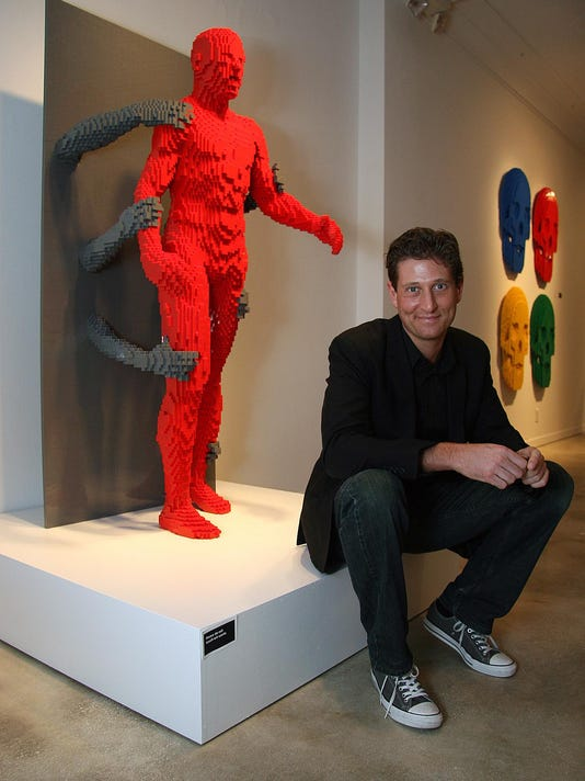 Nathan with Grasp sculpture