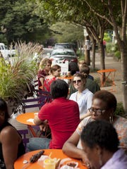 Outdoor seating can make a downtown more attractive and invite visitors to stay longer.