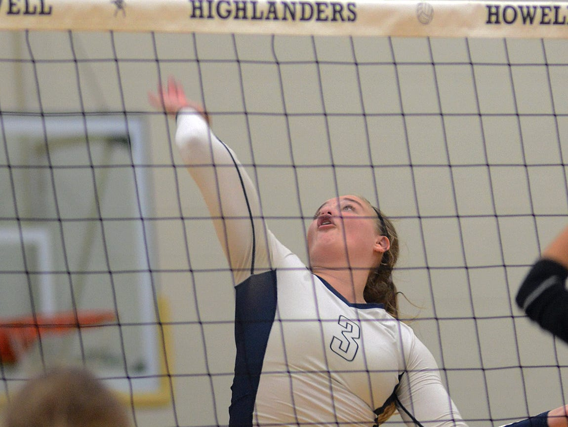 Hartland's Megan Acs was said by her coach to be the Player to Watch in the Class A District at Howell, and she was Wednesday night, coming up big down the stretch as Hartland beat Brighton, 3-2.