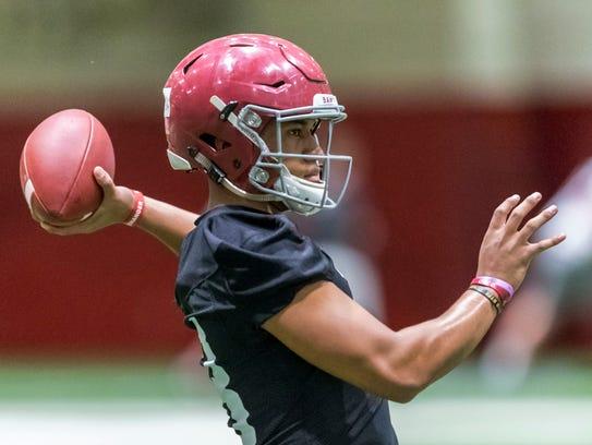 Alabama quarterback Tua Tagovailoa throws during the