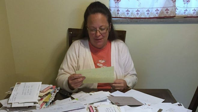 On Wednesday, Davis has been going through the hundreds and hundreds of letters sent to her at the jail.