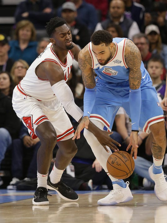 Chicago Bulls forward Bobby Portis, left, tries to steal the ball from Sacramento Kings center Willie Cauley-Stein during the first quarter of an NBA basketball game Monday, Feb. 5, 2018, in Sacramento, Calif. (AP Photo/Rich Pedroncelli)