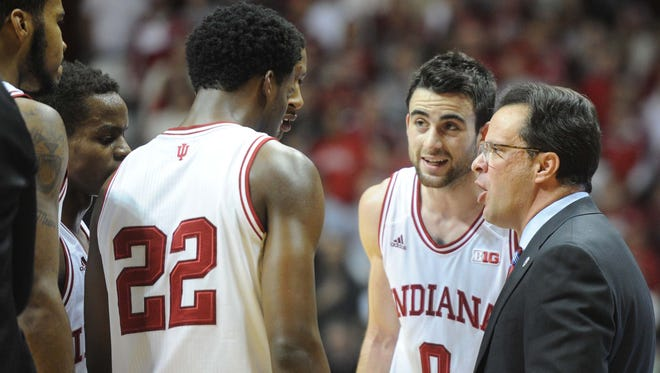 Tom Crean (right) and his team's leaders couldn't find a way to turn around Indiana's collapse at both ends of the floor Thursday night in Lincoln.