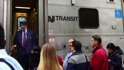 Commuters board an NJ Transit Train heading to Secaucus