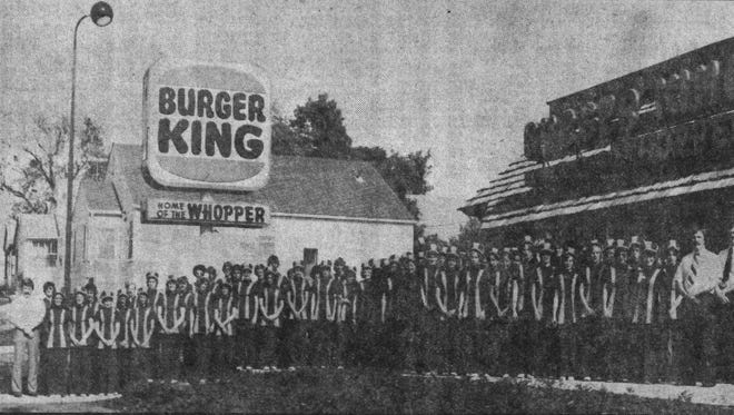 The original staff of the first Burger King on 10th Street is shown in this 1975 ad about the opening of the store.