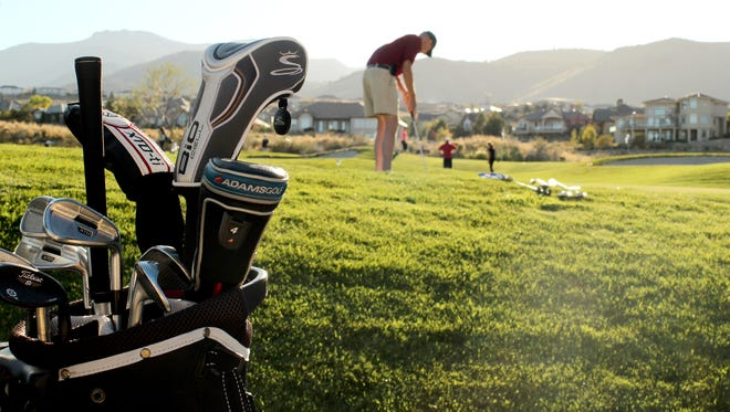 Ben Collins, 77, of Reno practices his swing at one of two golf courses at The Club at ArrowCreek Oct. 3, 2014.